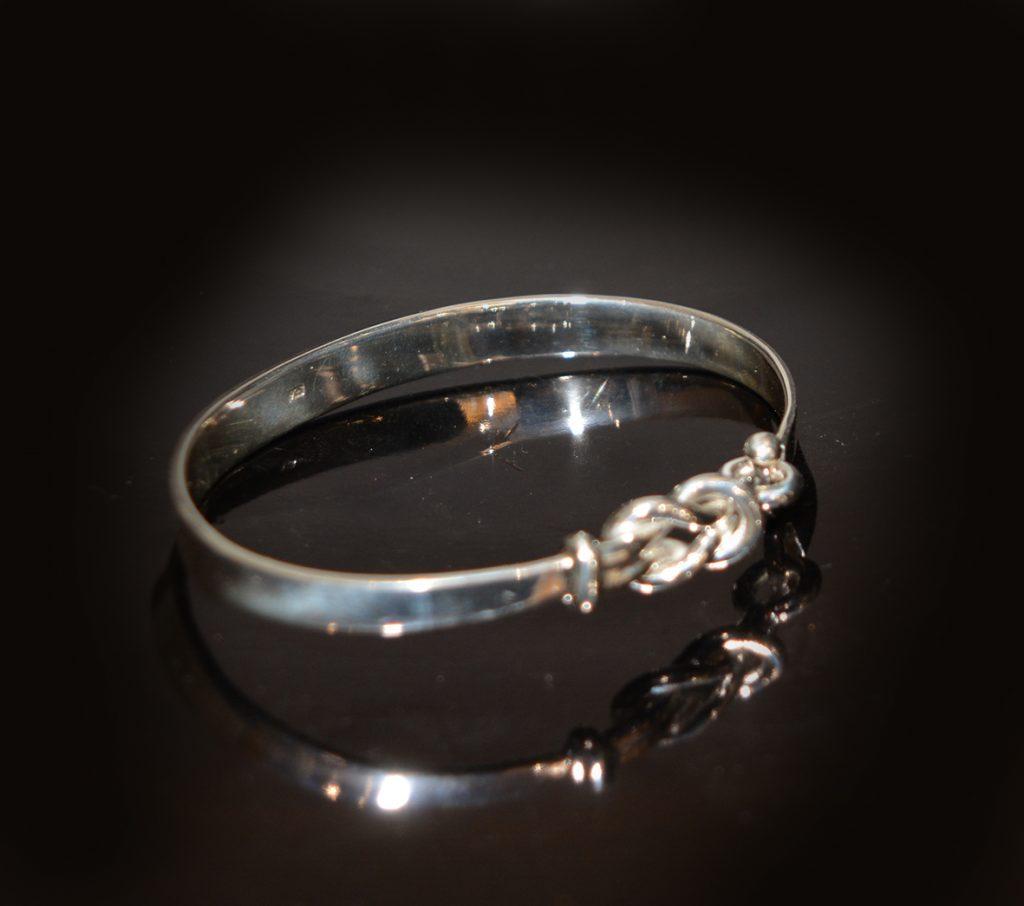 Silver love knot bangle £135.00